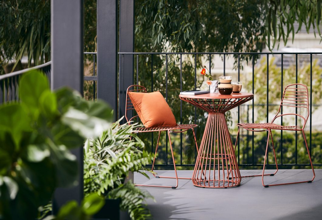 The Jil Table is a premium outdoor dining table with a fine-lined steel profile giving it a graceful form and a visually weightless quality.