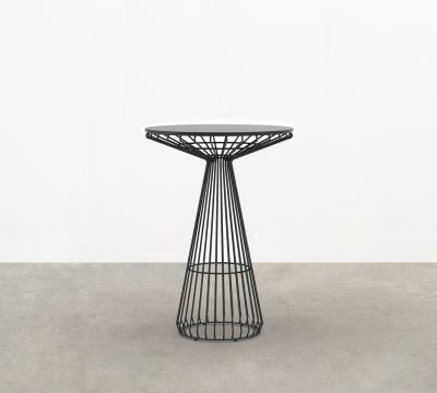 The Jil Bar Table - a premium outdoor bar table - has a wireframe structure that delivers an elegant form and fine-lined profile.