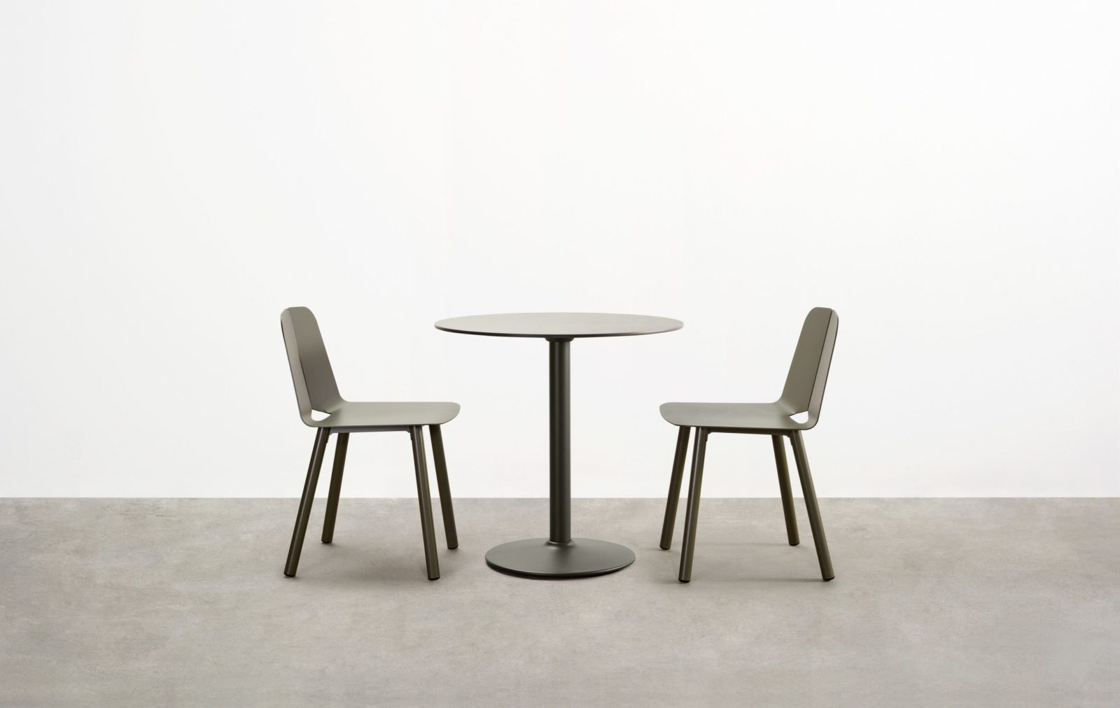 The Seam Café Table is a masterfully contemporary outdoor café table. Robust construction and materiality belie its sleek silhouette.