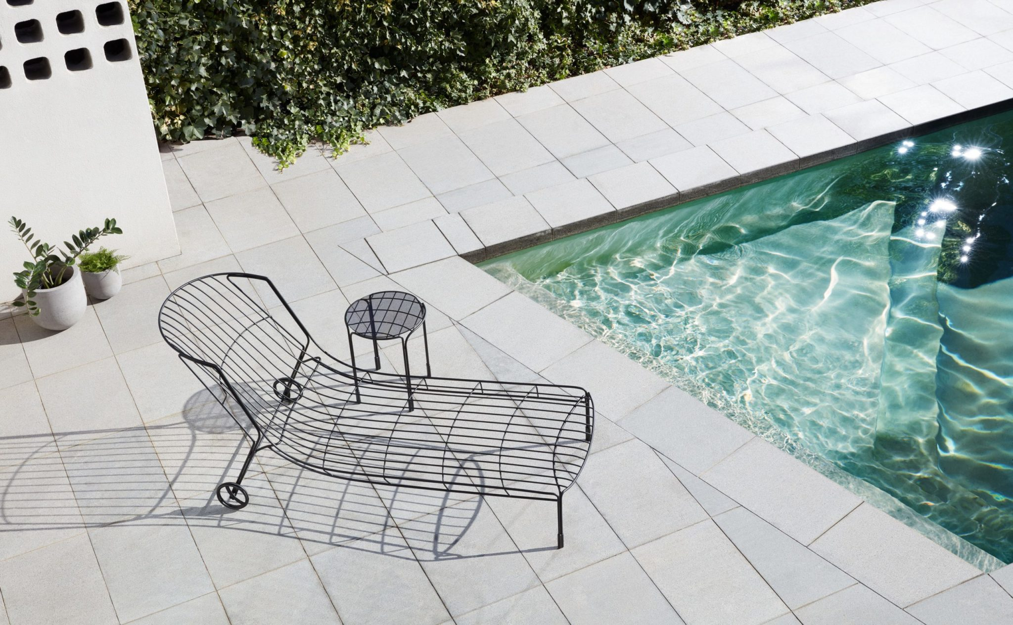 The Tidal Side Table - a supremely elegant outdoor side table - is a reflection of idyllic, sun-streaked summers of Australia in the '70s