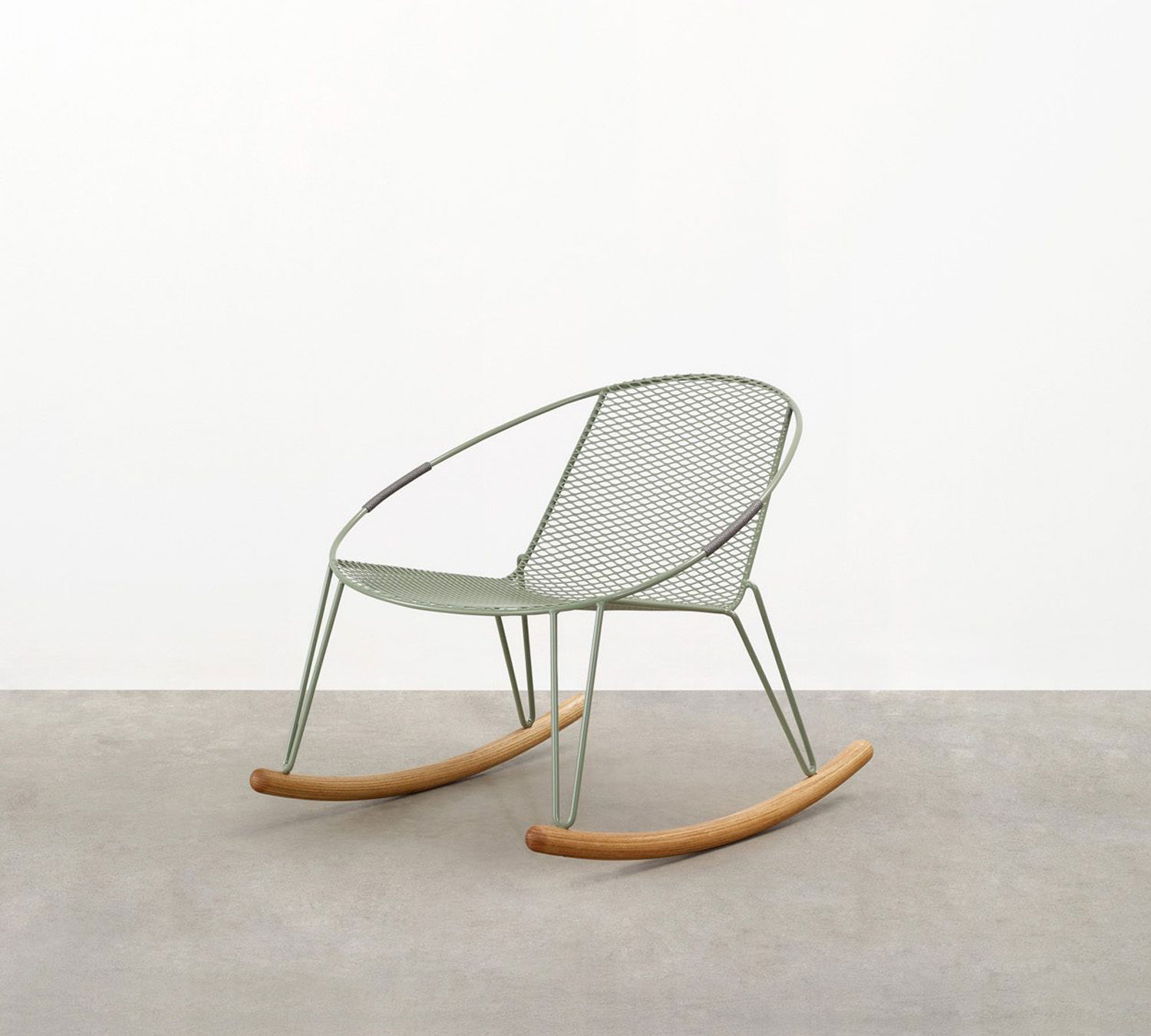 the Volley Rocker - a modern outdoor rocking chair with a distinct mid-century modern vibe designed by Adam Goodrum.