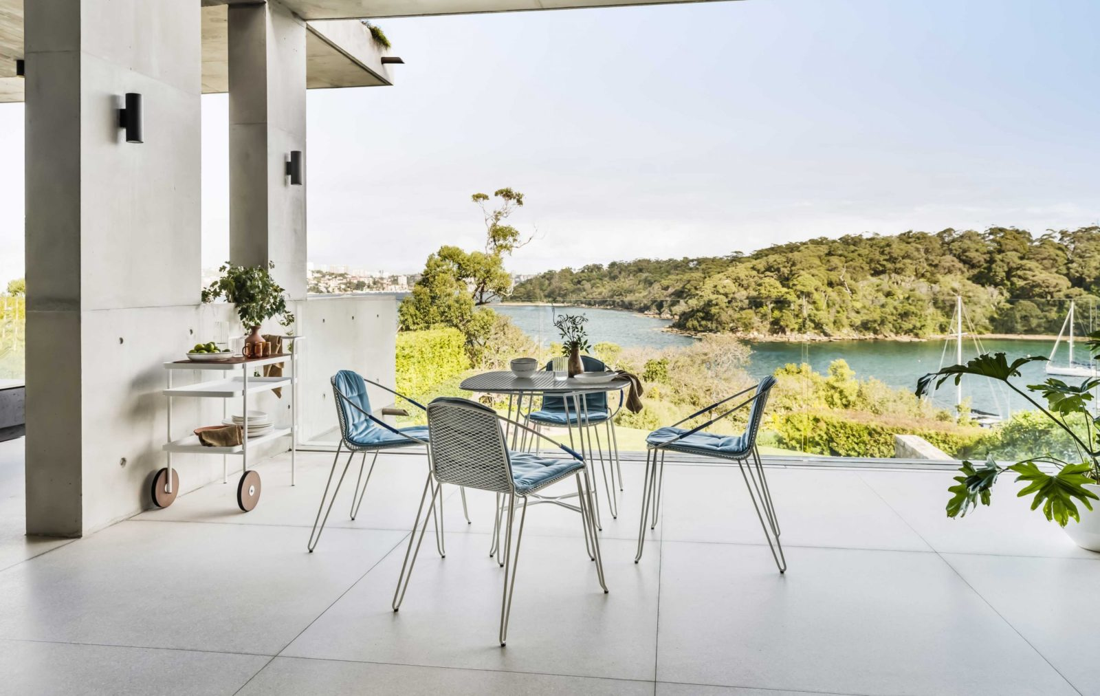 the Volley Chair - a modern outdoor dining chair with a distinct mid-century modern vibe designed by Adam Goodrum.