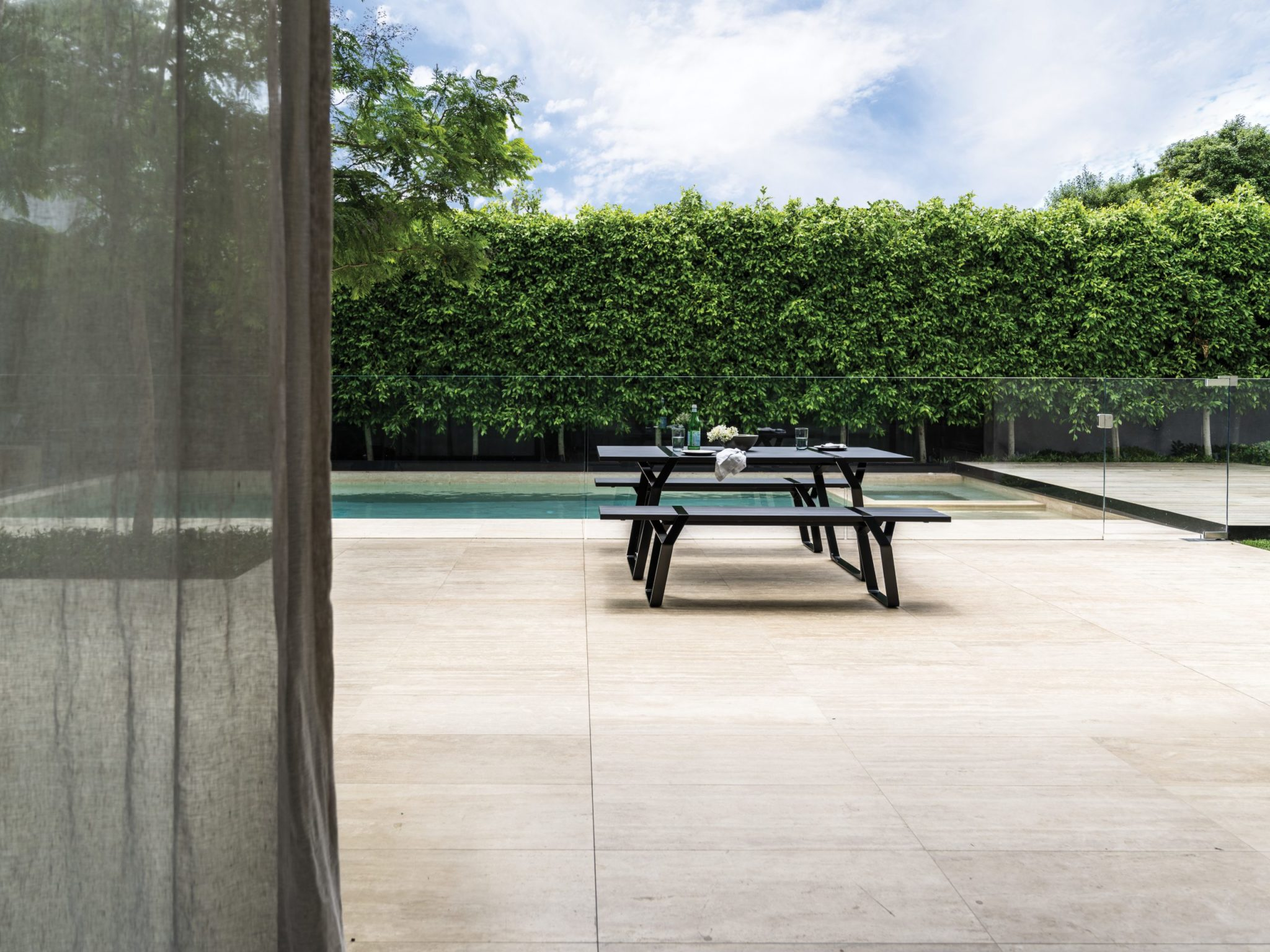Sophisticated and sturdy, the Flint Bench Seat designed by Ross Gardam, is a sleek outdoor bench seat with an elegant profile.