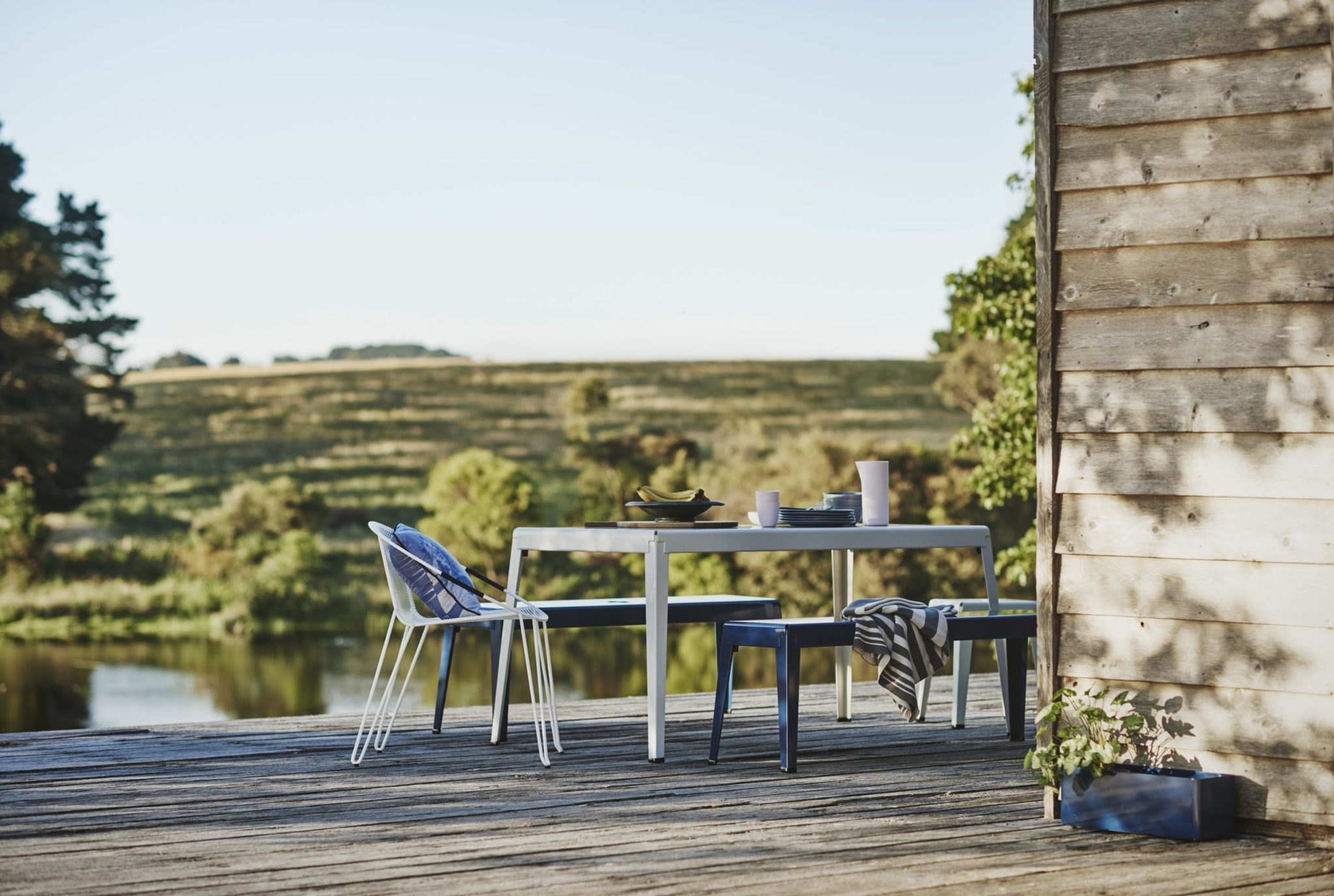 The Good One Table is an industrial style outdoor table prized for its industrial aesthetic and durability within outdoor contexts.