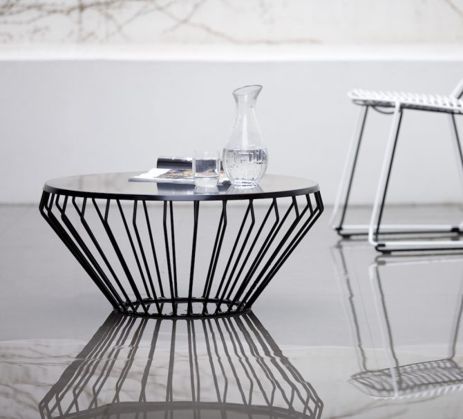 The Jil Coffee Table - a designer outdoor coffee table - has a wireframe structure that delivers graceful form and a fine-lined profile.