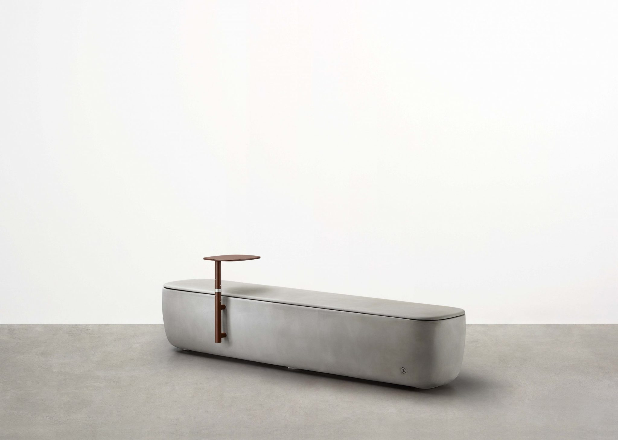 Designed by Adam Goodrum for Tait, the Scape Long Module is a long concrete bench seat that forms part of a fluid, triadic modular system.